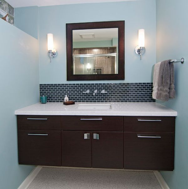 Dark-floating-cabinet-with-a-white-countertop-and-an-undermount-sink