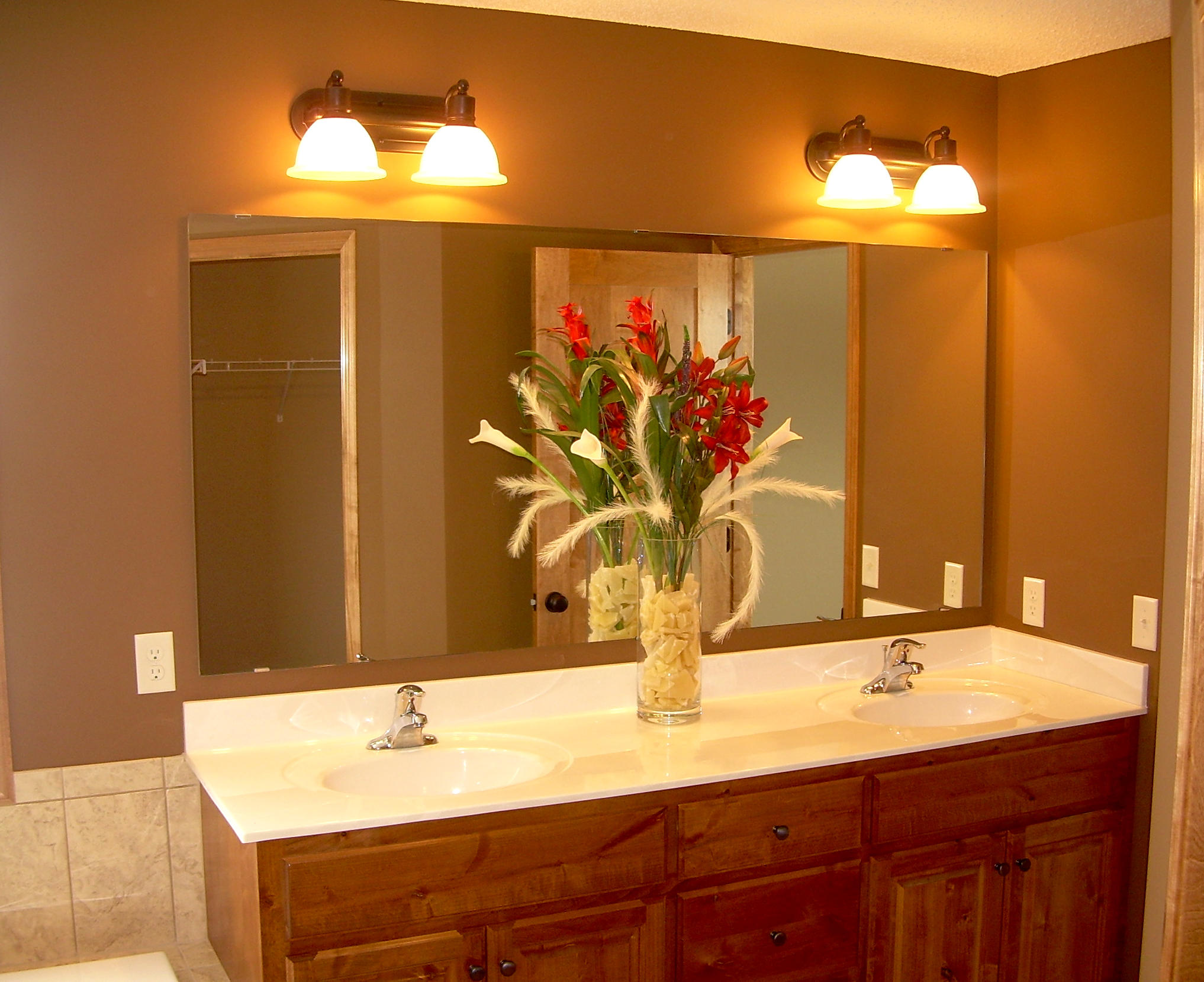 good bathroom lighting how to choose the best bathroom mirrors actual home 12994